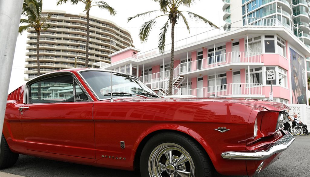 Car parked outside of retro hotel