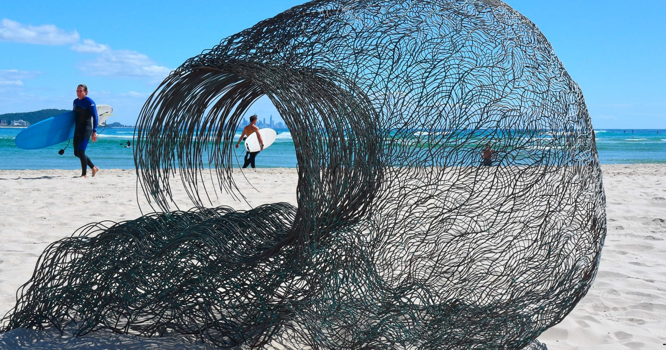 Artists prepare their sculptures for installation at SWELL Sculpture Festival.