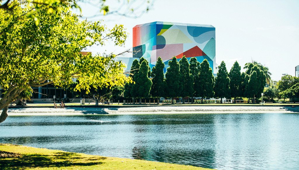 Colourful abstract building beside river