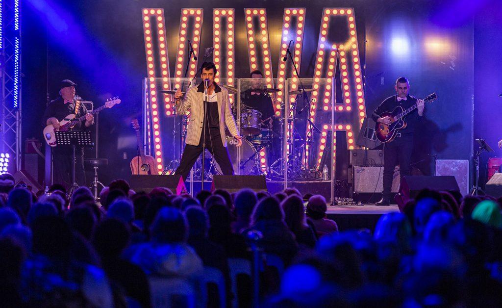 Elvis Tribute Artist performing on stage