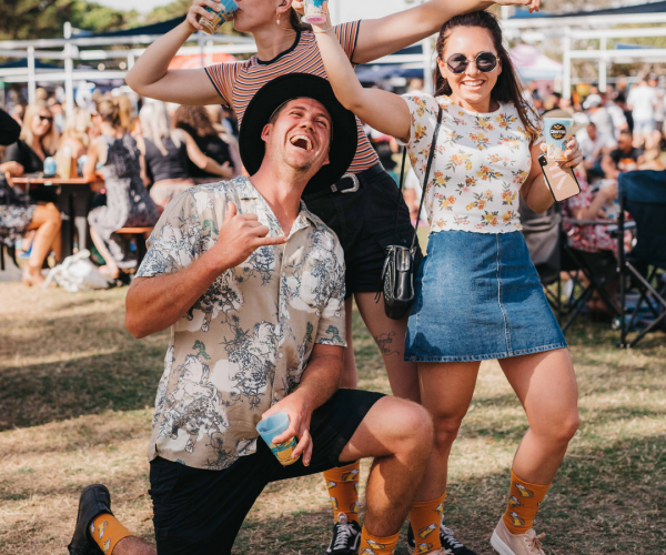 Group of friends posing for the camera at festival
