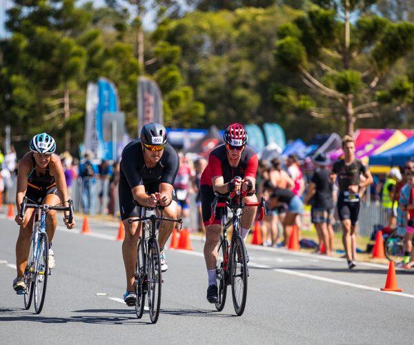 Athletes cycling in triathlon